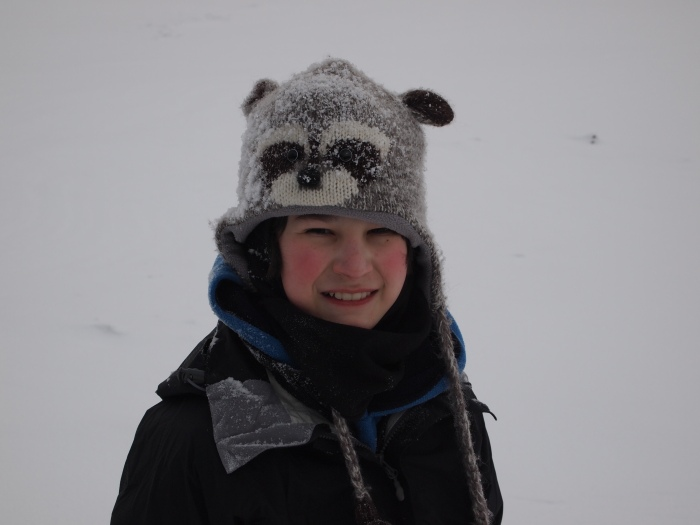 Youngest GeoKid's racoon touque gained a coat of snow during our short outing