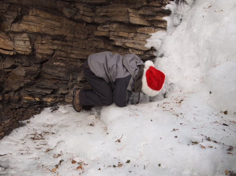 Youngest GeoK looks at a pocket of running water under the ice