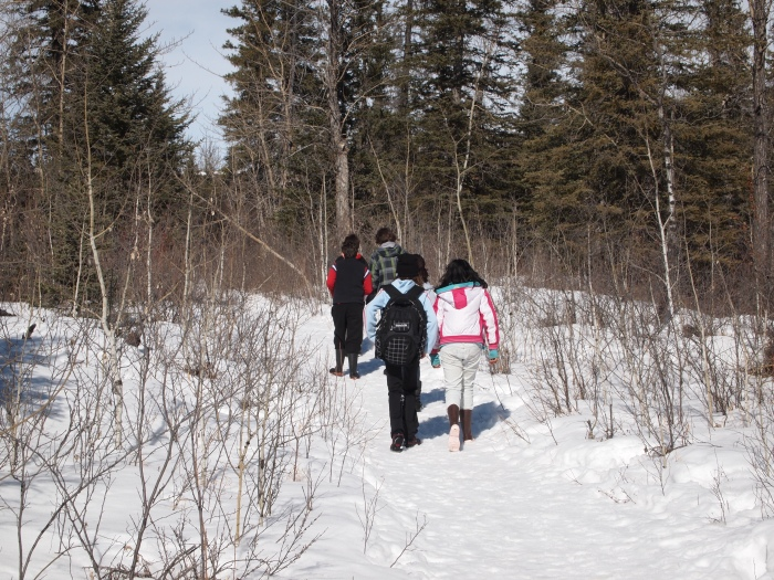 Grade 6 students geocaching in the Weaselhead
