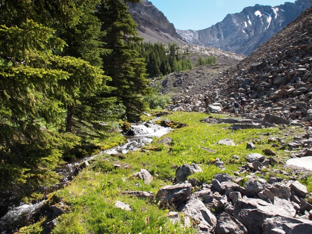 The trail to the first cirque is between a burbling creek and the edge of a talus field.