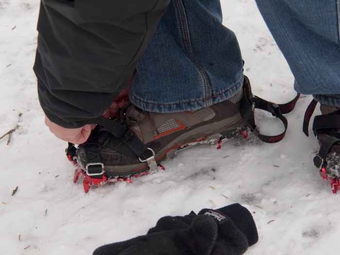 Mr. GeoK has to re-attach one crampon after a steep downhill section