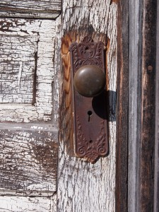 Faded paint and rusted door knob
