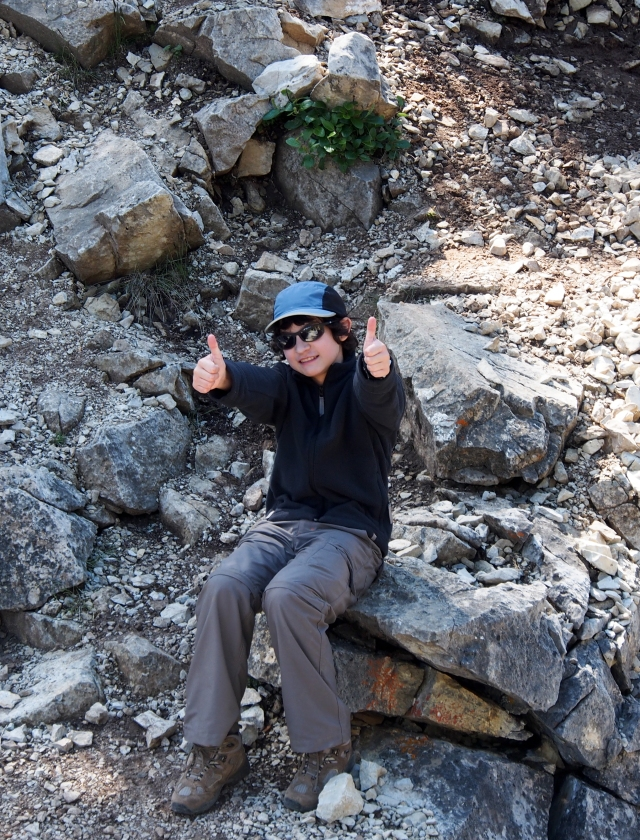 "K celebrates his successful crossing of ""the rock"" with two thumbs up!"