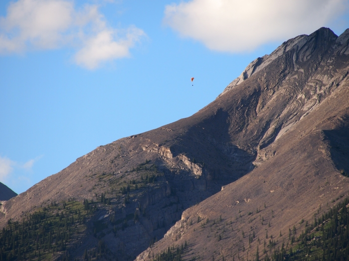 First paraglider just over Mount Lady MacDonald