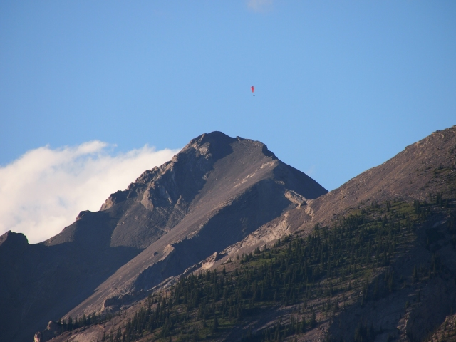 Second paraglider, over the secondary summit of Mount Lady MacDonald
