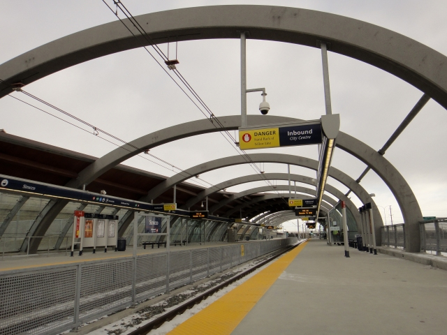 This above-ground station, located at 17th Ave and Sirocco Dr SW, is mostly open to the air with one covered section (near the front of the train) each side.