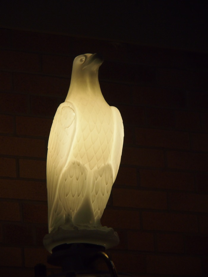 This illuminated eagle is the topper for an old-fashioned American Eagle gas pump on display in the lobby of the Gasoline Alley Museum.