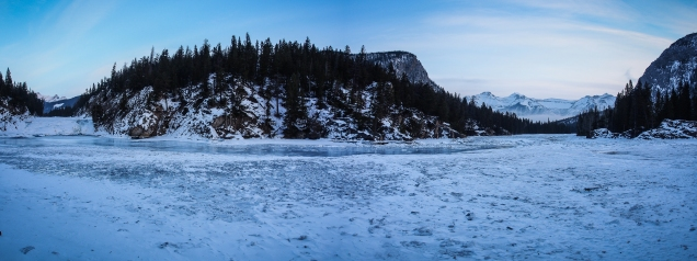 Frozen Bow Falls (on the left) near the confluence of the Bow River and Spray River