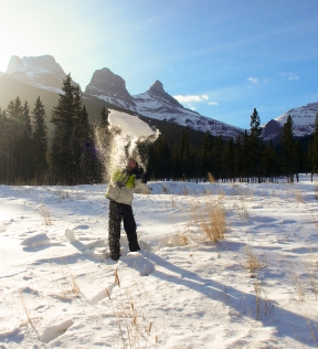 K throwing snow with the Three Sisters behind