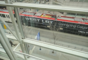 Westbound West LRT leaving downtown Calgary. This photograph was taken from a balcony in the Devonian Gardens - a large, indoor park in the heart of the city.