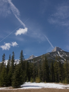 One fresh and one fading contrail over the Ship's Prow in Canmore.