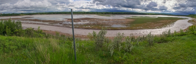 Glenmore Reservoir - water level is very low with one fast-moving channel along the near shoreline