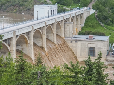 Floodwaters spilling over Glenmore Dam when the pedestrian/bicycle bridge over top was closed.