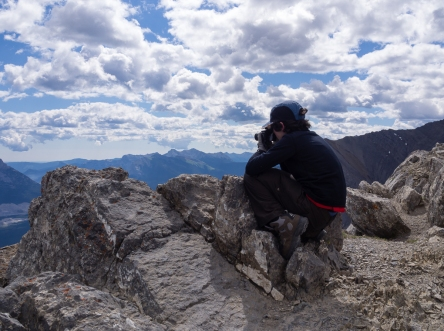 K perches at the top of Ha Ling to take some photos of Canmore