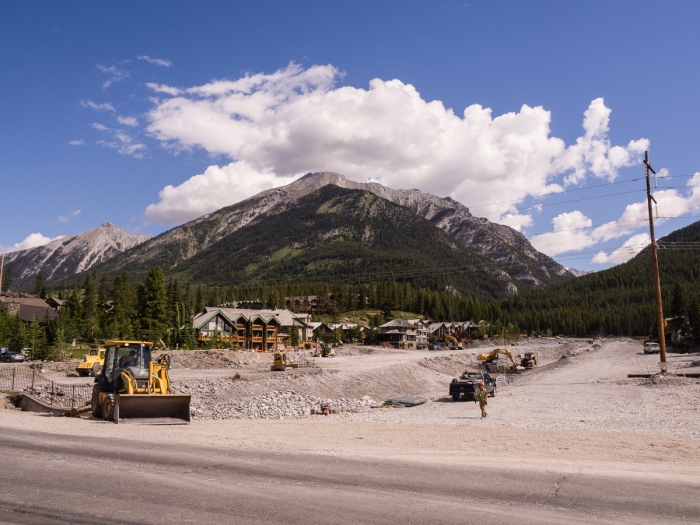 Temporary repair work underway along Cougar Creek, upstream of Elk Run Blvd.