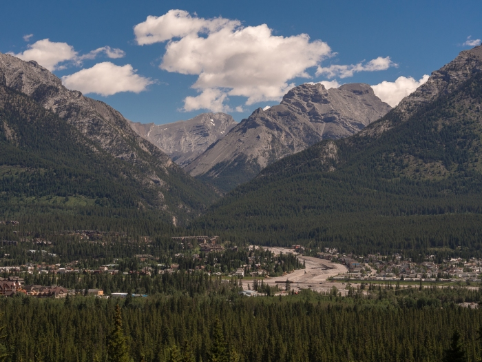 An overview of post-flood Cougar Creek taken from the benchland across the Bow Valley