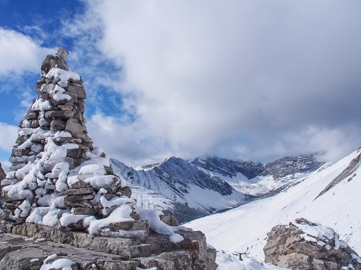 This carefully constructed cairn is topped by a sculpture of sorts - some rocks carefully positioned to create the strong impression of a hiker - torso, pack and head. Do you think the hiker's gazing a Ptarmigan Cirque, Mount Rae or across the valley to Pocaterra Cirque and Mount Tyrwhitt?