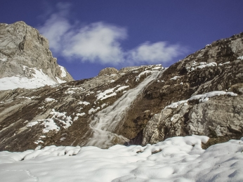 And this photo of the upper falls was taken by Mrs. GeoK, who wanted to show the animal tracks in the snow and the corner of the bluff running along the north side of the cirque.