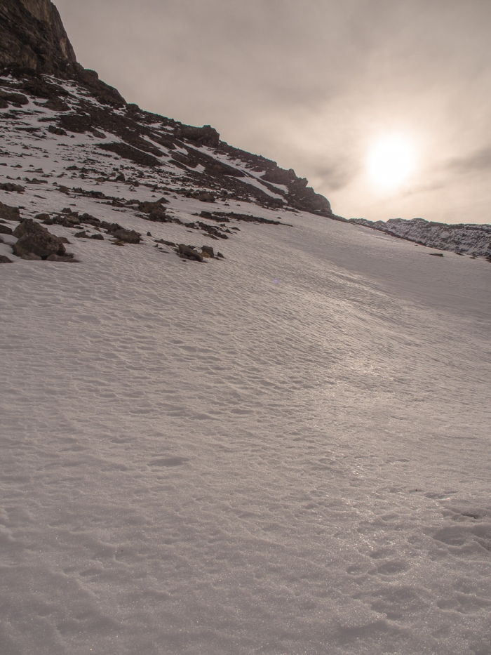 The midday sun reflected off the hard-packed and wind-sculpted snow blanketing the shoulder of Mount Arethusa.