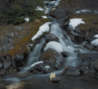 This waterfall is where the one creek is coming down the steep side slope off the shoulder of Mount Arethusa to join the creek draining the cirque and running down towards Highway 40