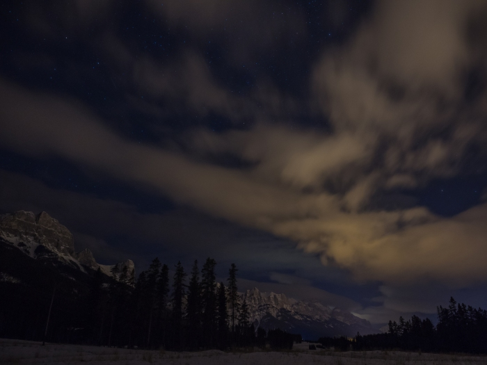 Once again, the night wind was blowing clouds from west to east along the Bow Valley. Street lights in the town of Canmore actually helped Mr. GeoK achieve a good mix of highlights and shadows in this photograph of clouds over Mount Rundle.
