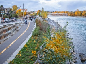 Photowalk participants make their way along the Bow River pathway north of downtown Calgary.