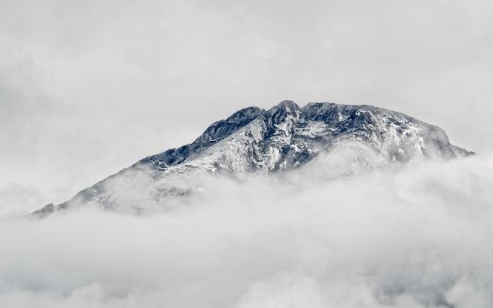 mountain-through-clouds