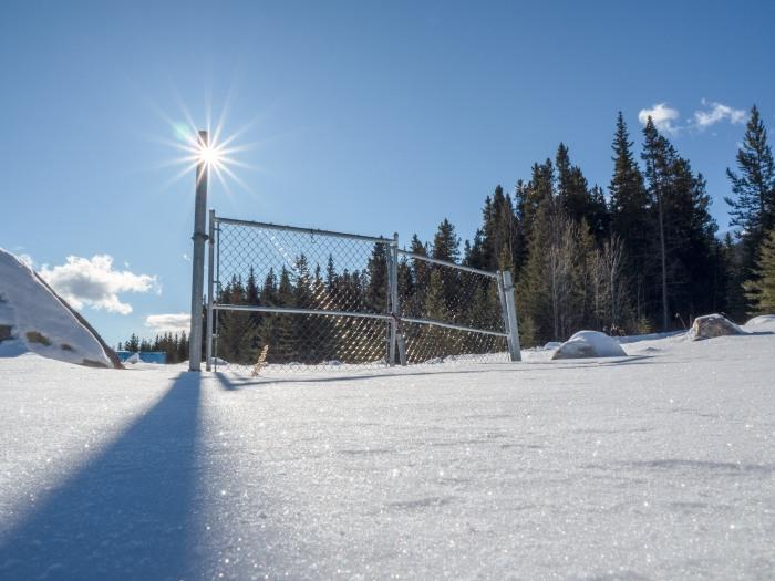 sun-flare-fence-shadow