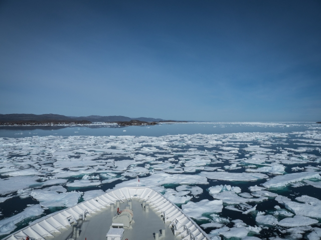 Bow of ship navigating through loose sea ice in Frobisher Bay