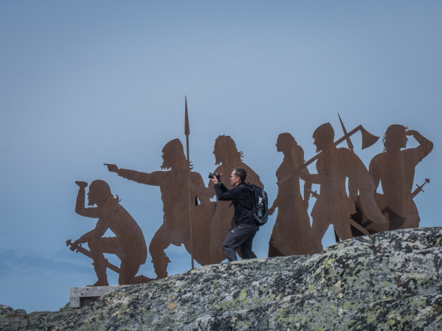 Photographer with camera pretending to be a Viking Explorer