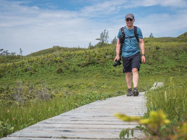 man-walking-on-boardwalk
