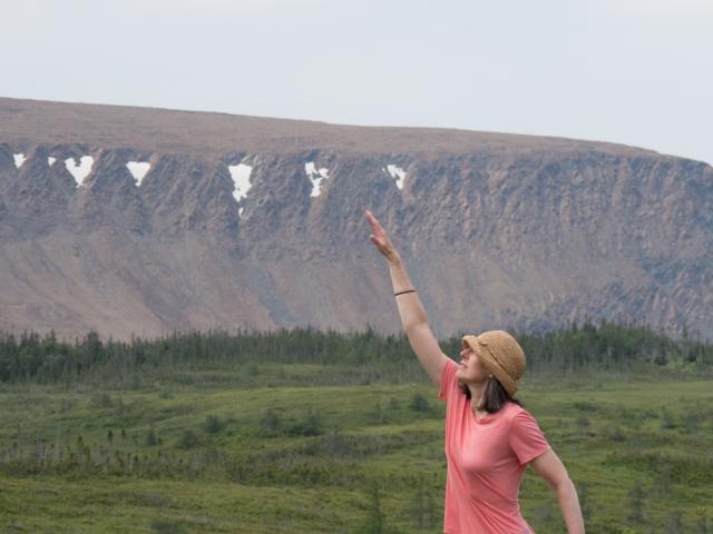 woman-reaching-for-mountain